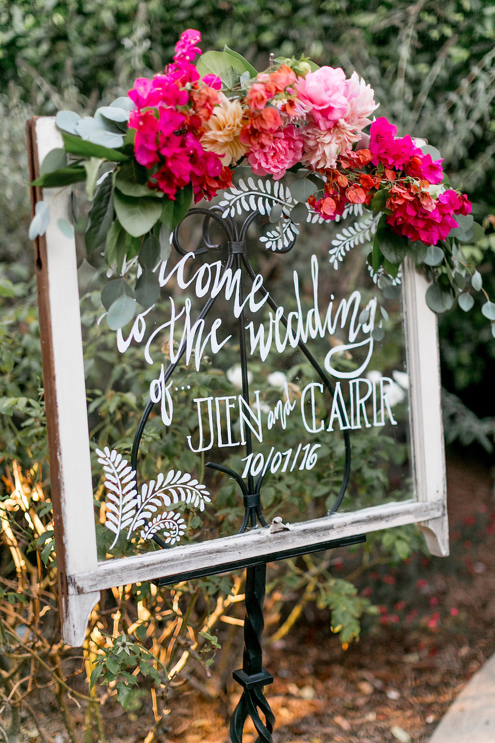 Bohemian wedding welcome sign with floral garland by Compass Floral | Estancia Hotel & Spa, La Jolla.