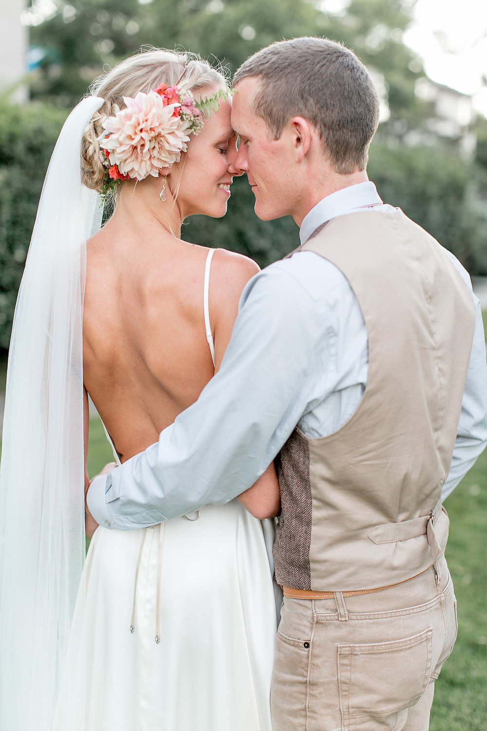 Bohemian bride & groom with bridal hair florals by Compass Floral | Estancia Hotel & Spa, La Jolla.