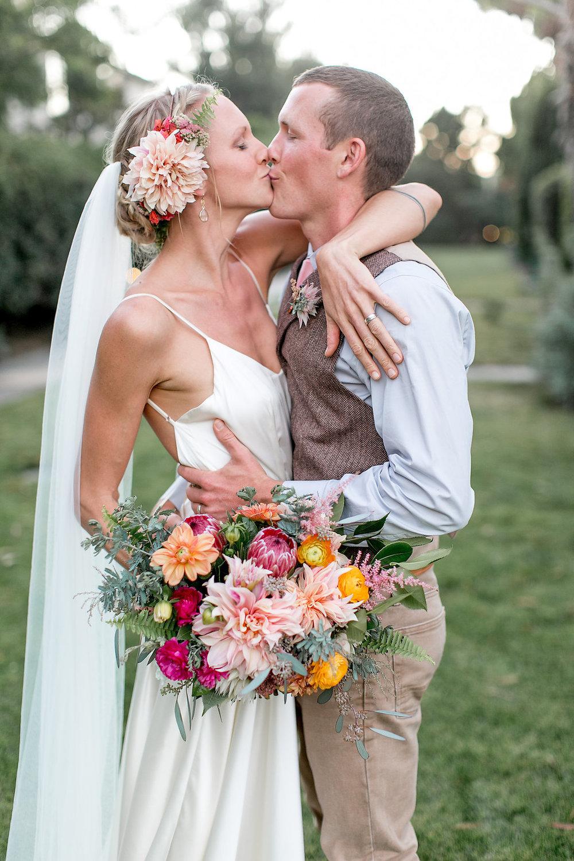 Cafe au lait dahlia, protea and ranunculus desert bohemian bridal bouquet by Compass Floral | Estancia Hotel & Spa, La Jolla.