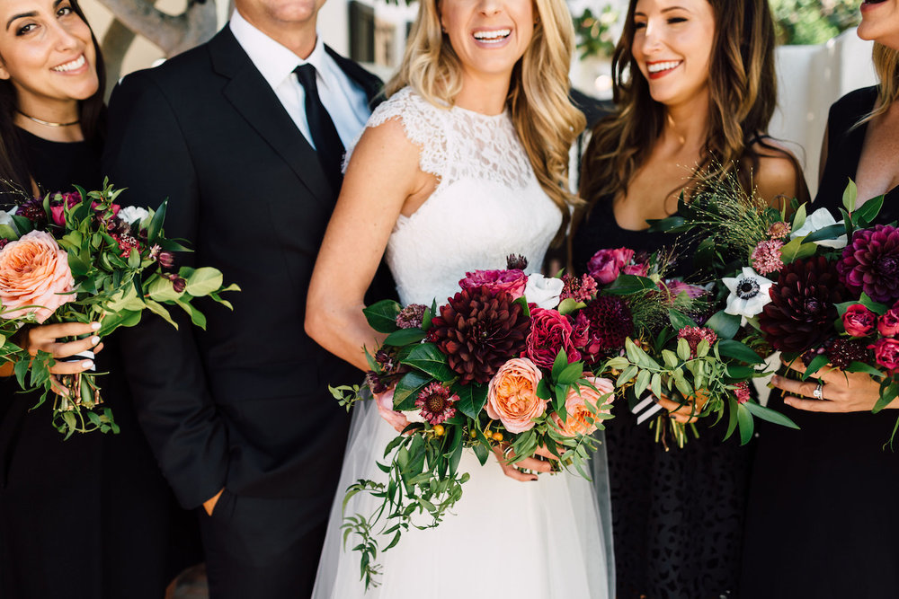 Modern, classic wedding party in black with colorful florals by Compass Floral | Darlington House, La Jolla.