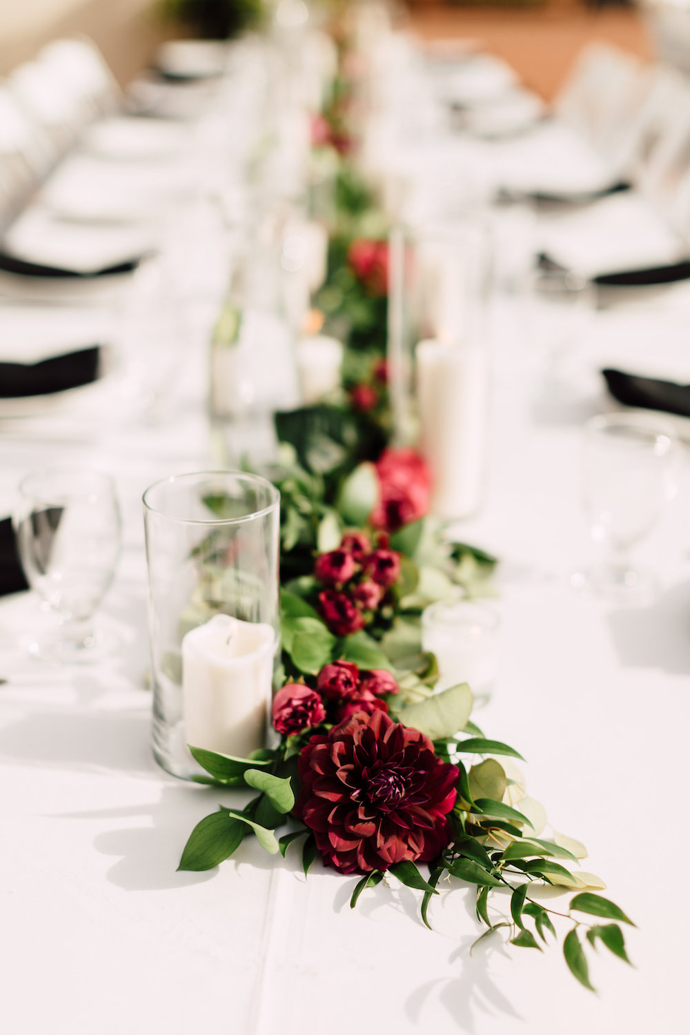 Head table garland with candles by Compass Floral | Darlington House, La Jolla.