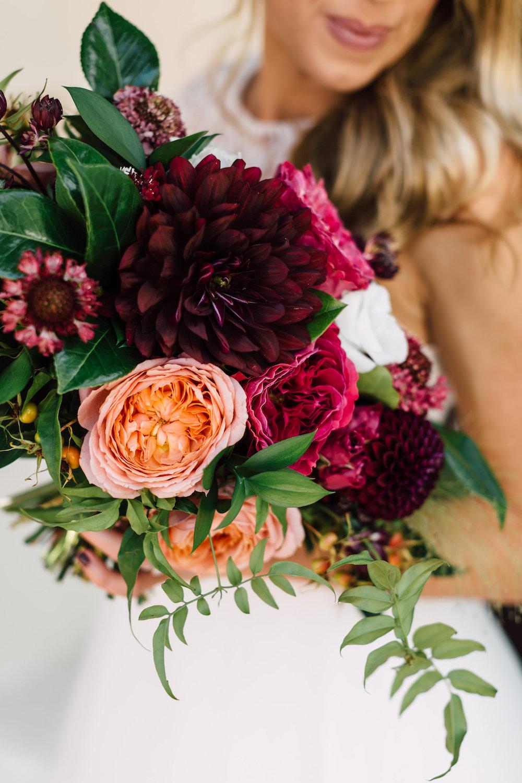 Burgundy, marsala, maroon and peach garden rose and dahlia bridal bouquet by Compass Floral | Darlington House, La Jolla.