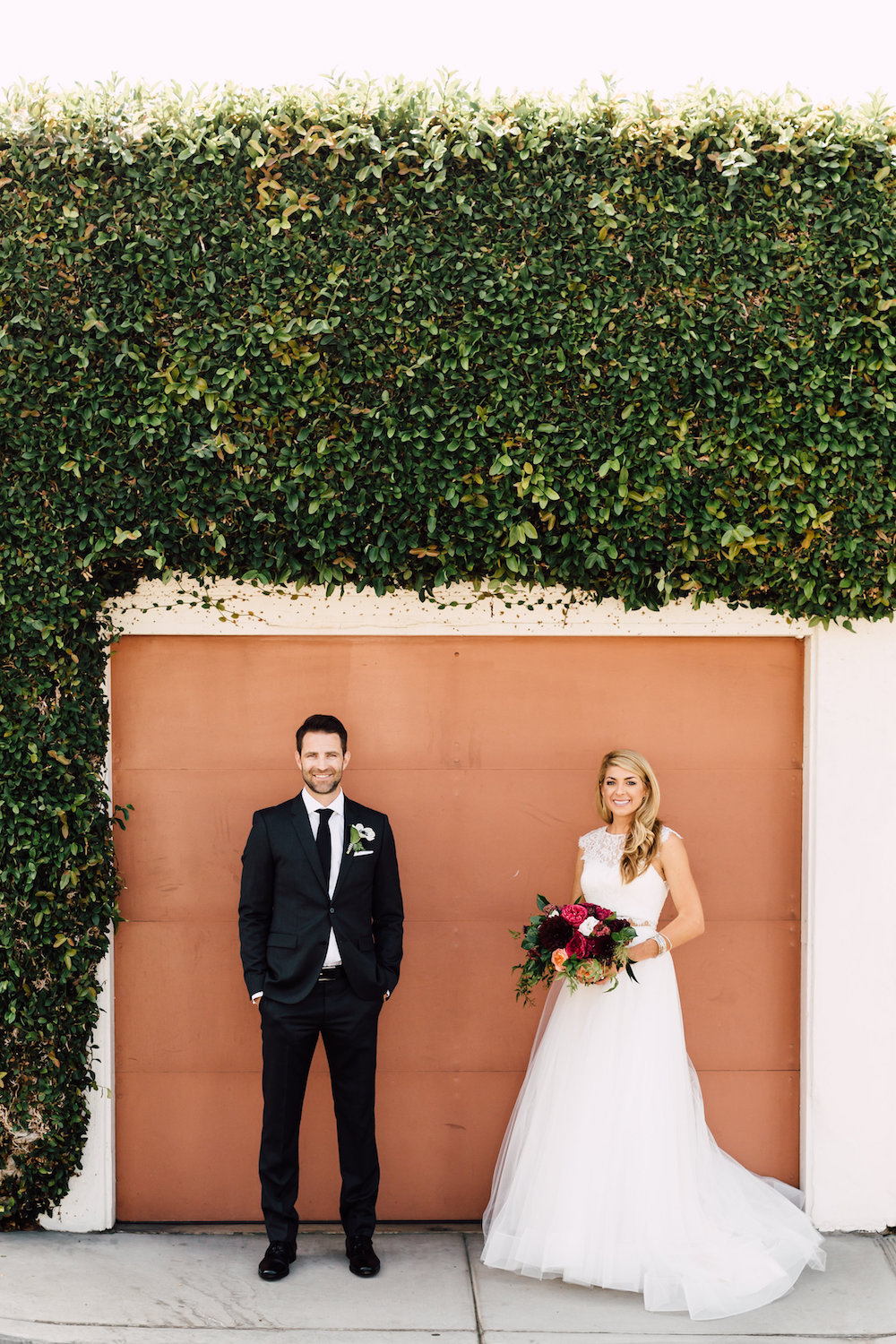Modern, classic, colorful bride and groom with garden rose and dahlia bridal bouquet by Compass Floral | Darlington House, La Jolla.