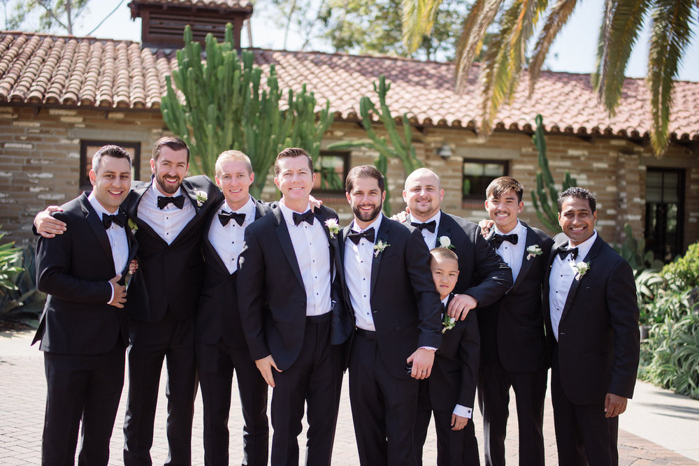 Black bow-tie groomsmen, boutonnieres by Compass Floral | Estancia Hotel & Spa, La Jolla
