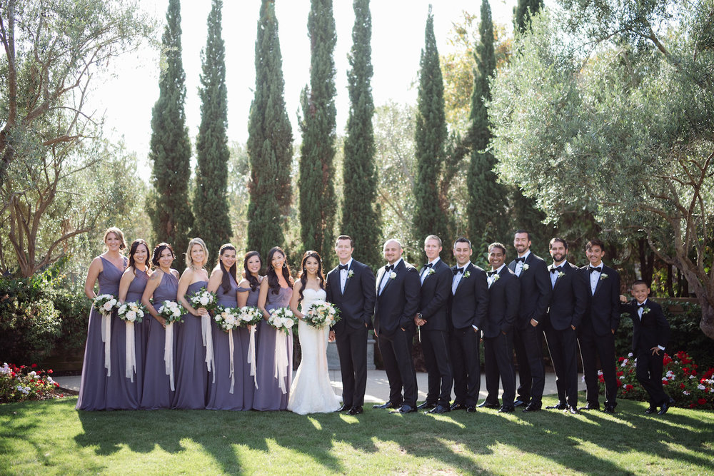 Classic, elegant wedding party at Estancia Hotel & Spa, La Jolla by Compass Floral.
