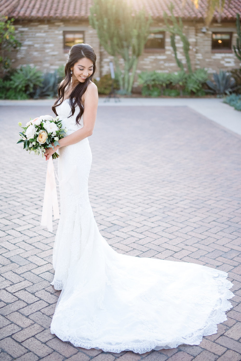 Ivory & blush bridal bouquet with trailing ribbons by Compass Floral | Estancia Hotel & Spa, La Jolla.