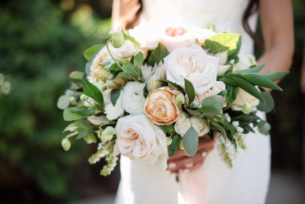 Garden rose, hellebore, pieris & ranunculus bridal bouquet by Compass Floral | Estancia Hotel & Spa, La Jolla