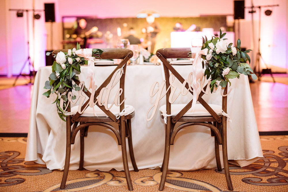 Sweetheart chair back florals wedding reception by Compass Floral | Estancia Hotel & Spa, La Jolla.