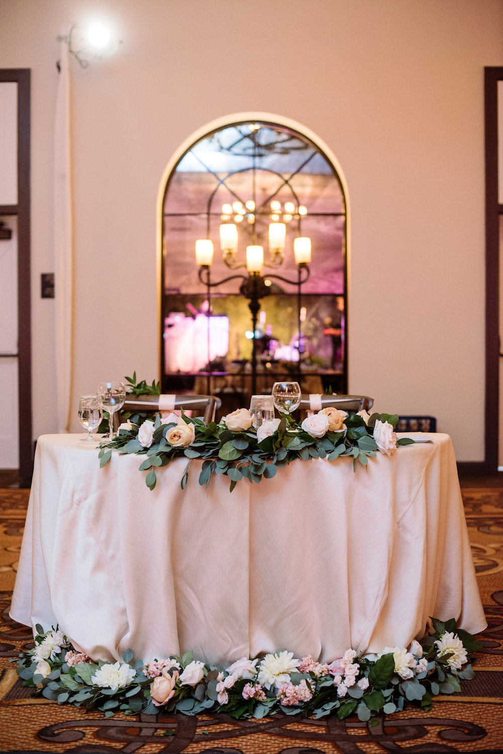 Sweetheart table floral garland wedding reception by Compass Floral | Estancia Hotel & Spa, La Jolla.