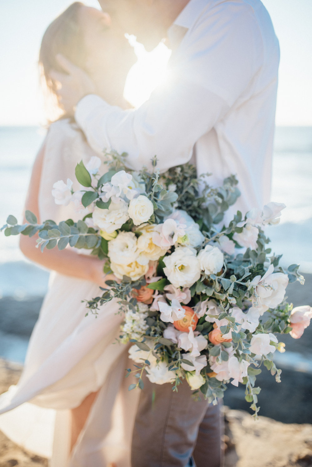 Ivory, blush & peach bridal bouquet by San Diego florist, Compass Floral // Eva Lin Photography.