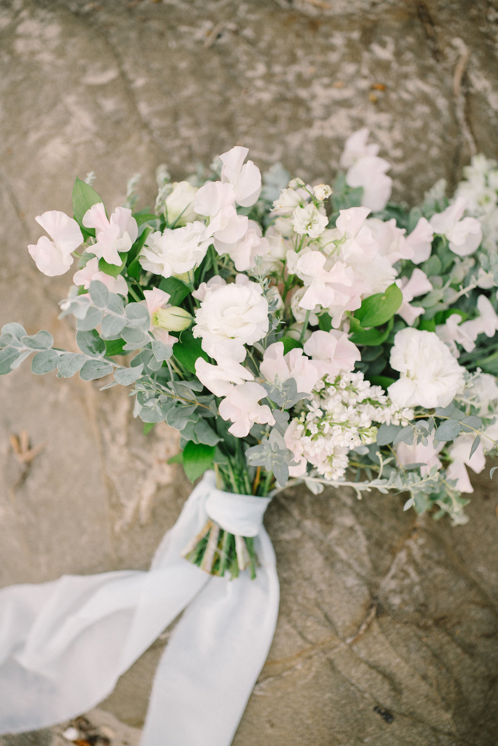 Green & ivory summer bouquet of lilac, sweet pea and lisianthus by Compass Floral. Design & Planning // Events by Talissa Photographer // Garrett Richardson