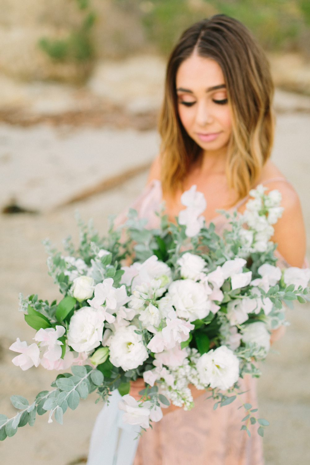 Bachelor contestant Sarah Vendal with summer bouquet of lilac, sweet pea and lisianthus by Compass Floral. Design & Planning // Events by Talissa Photographer // Garrett Richardson