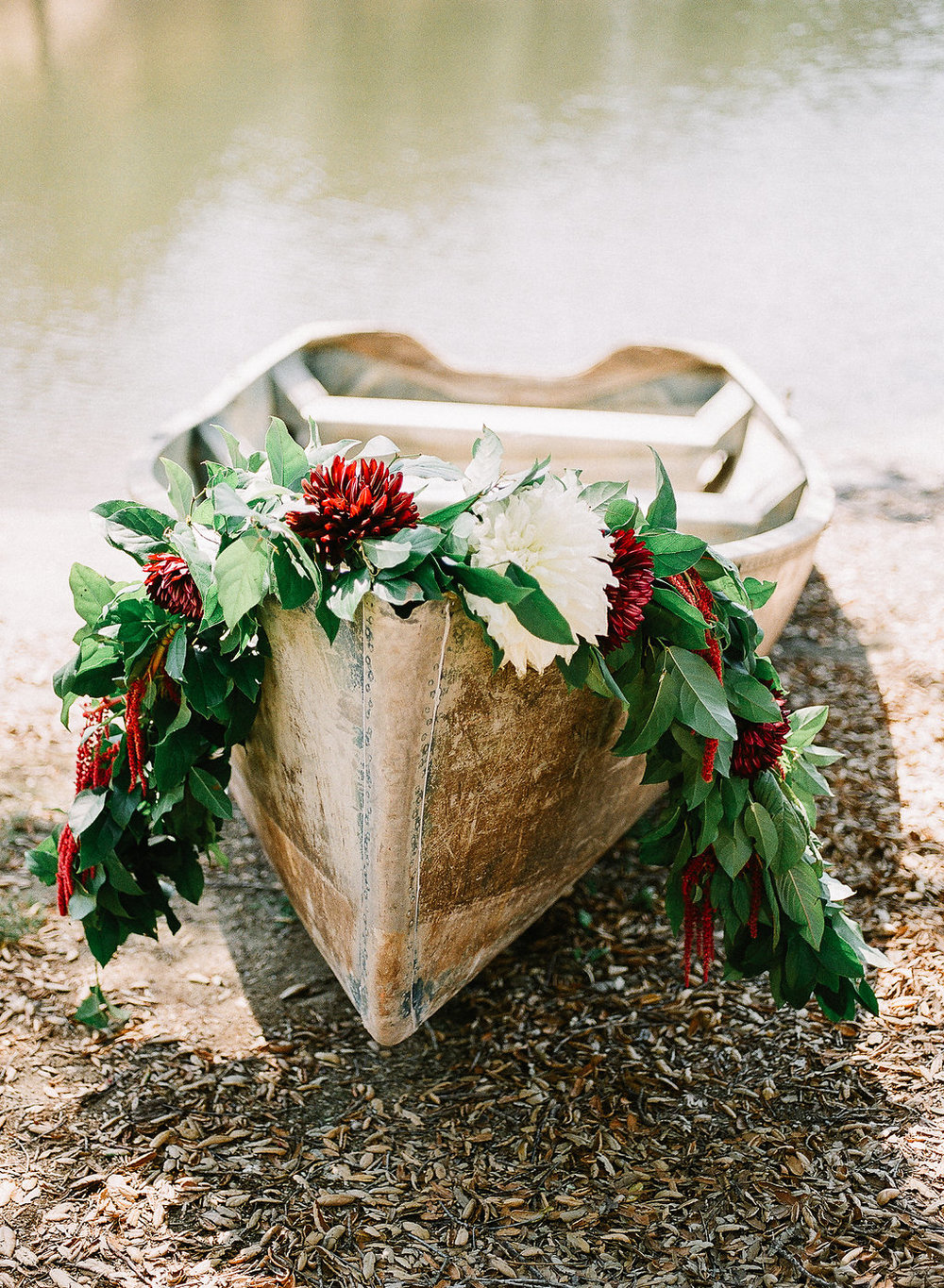 Garland and flowers on a row boat | Fallbrook Treehouse | Compass Floral | Wedding Florist in San Diego and Southern California | Allie Lindsey Photography