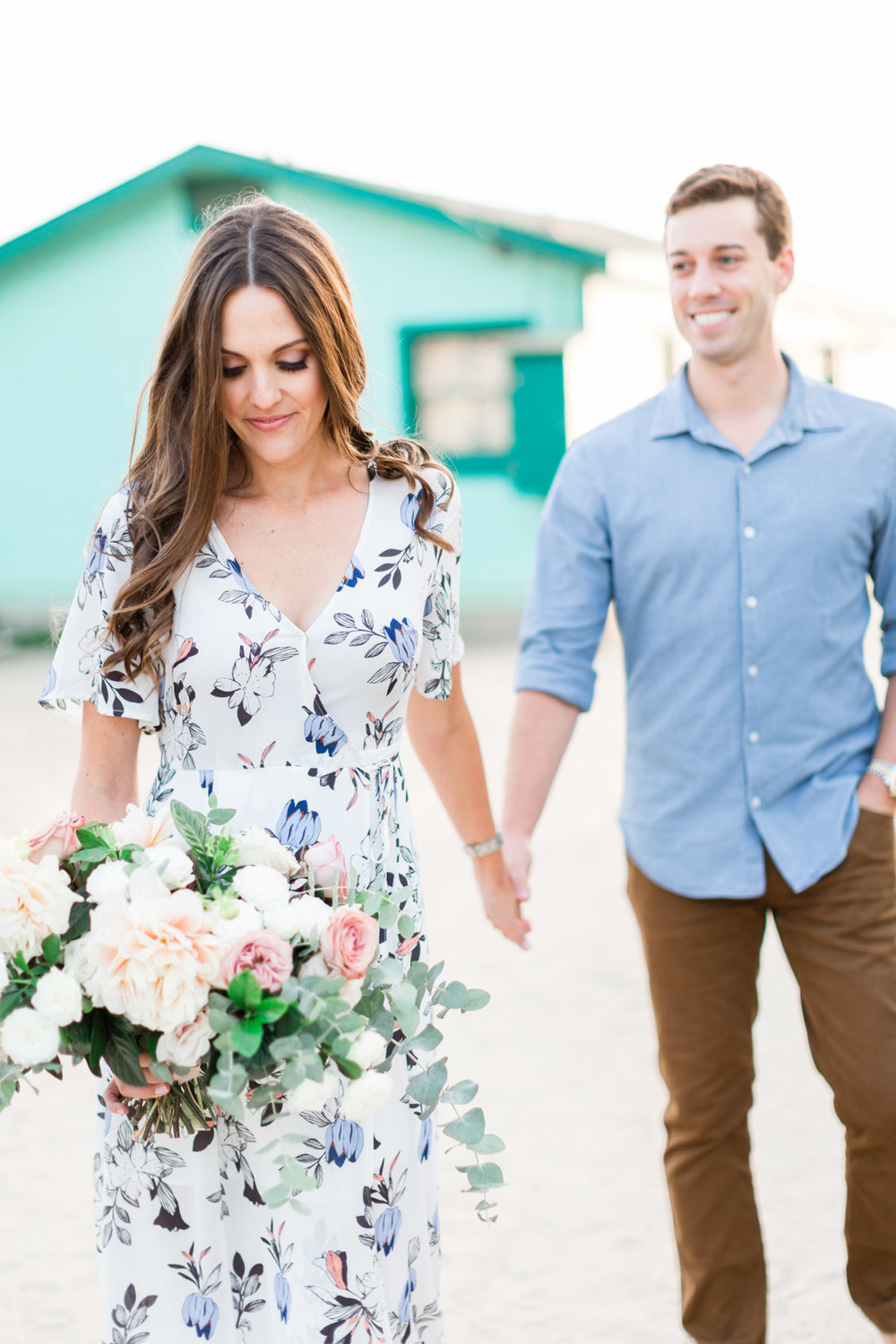 Elegant and romantic blush dahlia, white rose and eucalyptus bouquet for fun beach engagement photo session | Newport Beach, CA | Compass Floral | Wedding Florist in San Diego and Southern California | Cavin Elizabeth Photography