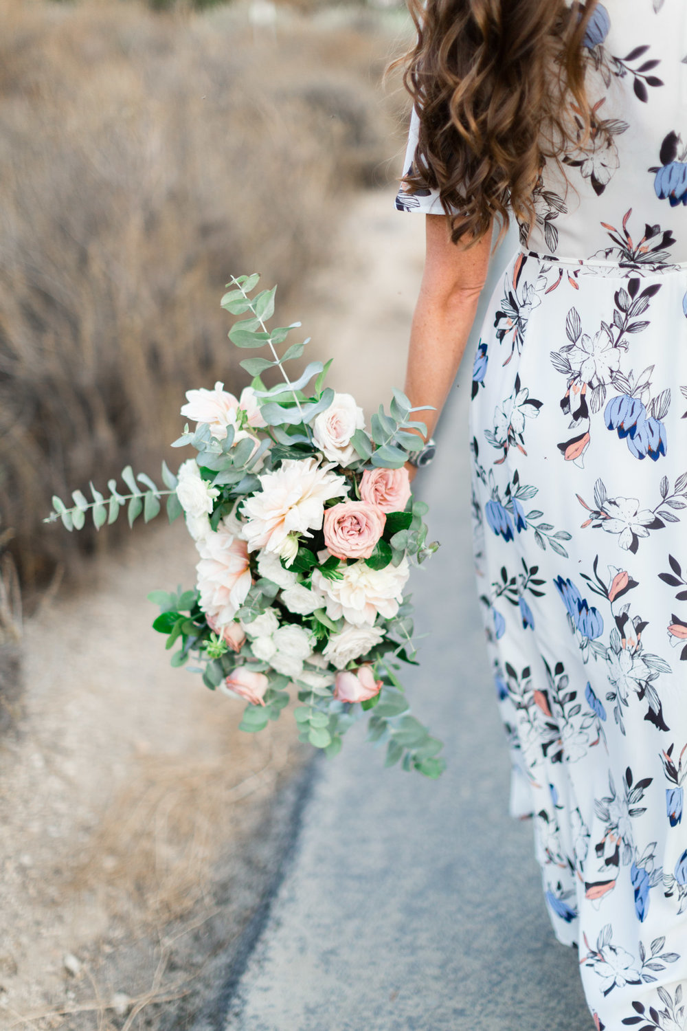 Fun bridal bouquet of blush dahlias, white roses and eucalyptus for beach engagement photo session | Newport Beach, CA | Compass Floral | Wedding Florist in San Diego and Southern California | Cavin Elizabeth Photography