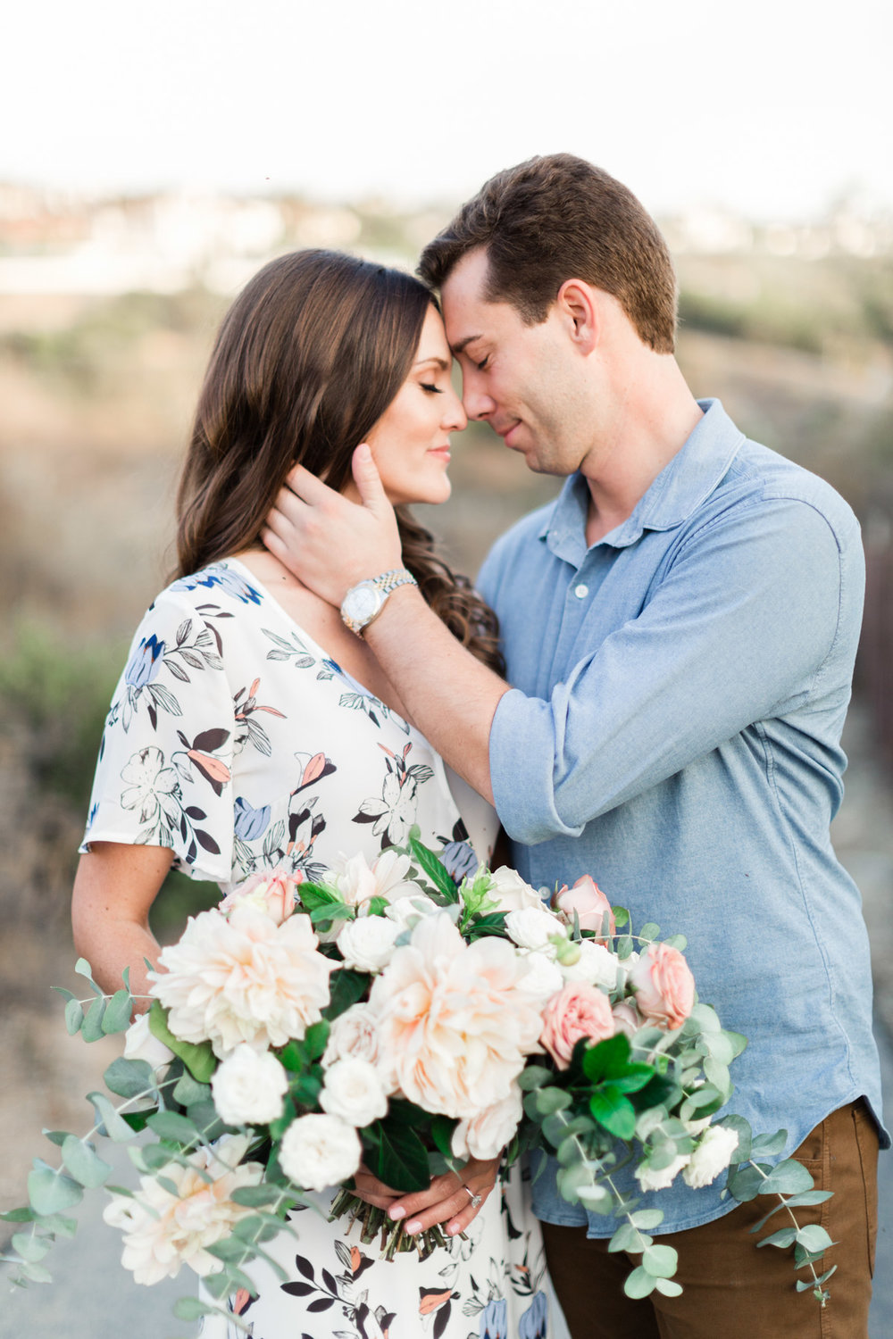 Classic blush dahlia, white rose and eucalyptus bouquet for down to earth beach engagement photo session | Newport Beach, CA | Compass Floral | Wedding Florist in San Diego and Southern California | Cavin Elizabeth Photography