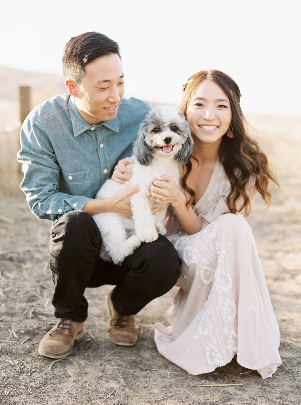Dreamy golden hour field engagement photo session with dog |  Compass Floral | Wedding Florist in San Diego and Southern California | Meiwen Wang Photography    #gardenromantic       #sandiegowedding     #sandiegoweddingflorist       #orangecountyflorist     #floraldesign       #dreamwedding     #fineartwedding     #fineartflowers     #fineartcuration     #weddingdetails     #weddinginspiration    #engaged #engagementphotos #fieldphotos #dreamyphotos #goldenhour #engagementphotooutfitinspiration  #weddingdog #flowerdog #floraldogcollar #dogcollarflower #dogcollar #puppydog #doglovers #dogsandflowers #puppyeyes #puppycuddles #shichons #bichon #shihtzu