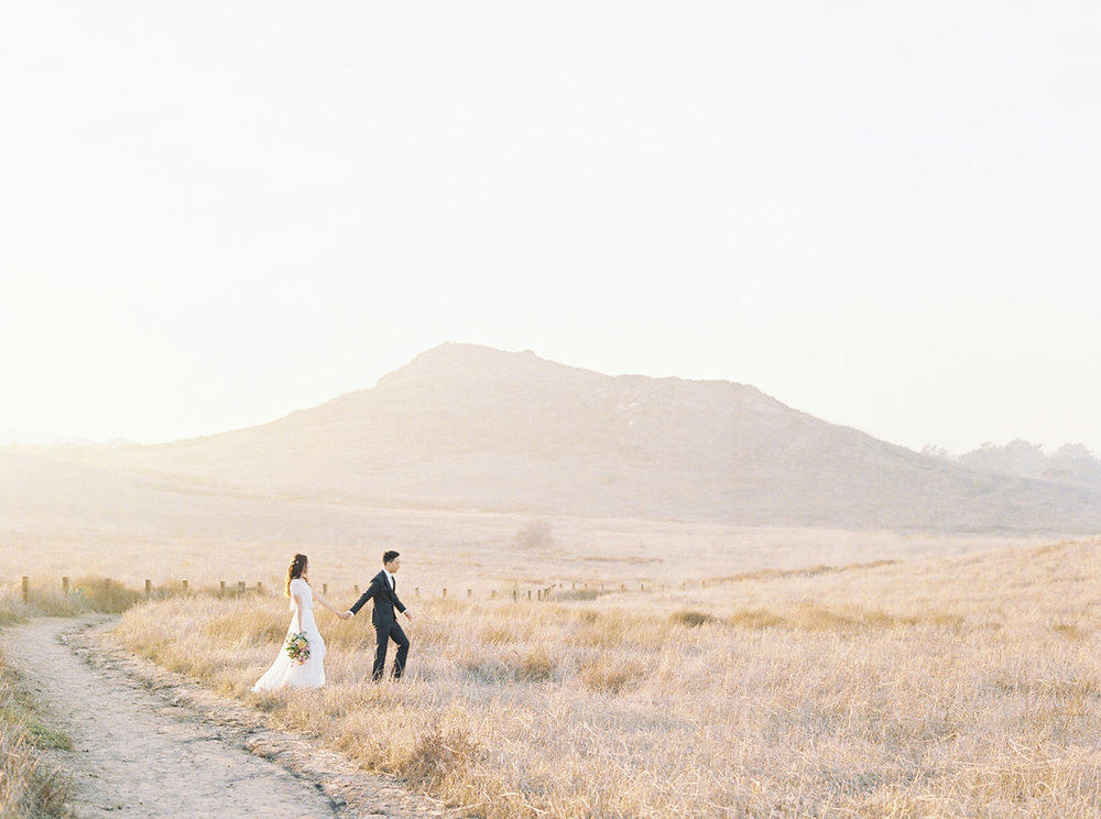 Dreamy golden hour field engagement photo | Bouquet by Compass Floral | Wedding Florist in San Diego and Southern California | Meiwen Wang Photography    #gardenromantic       #sandiegowedding     #sandiegoweddingflorist       #orangecountyflorist     #floraldesign       #dreamwedding     #fineartwedding     #fineartflowers     #fineartcuration     #weddingdetails     #weddinginspiratio   n #engaged #engagementphotos #engagementphotooutfitinspiration #fieldphotos #dreamyphotos #goldenhour  #engagementphotobouquet