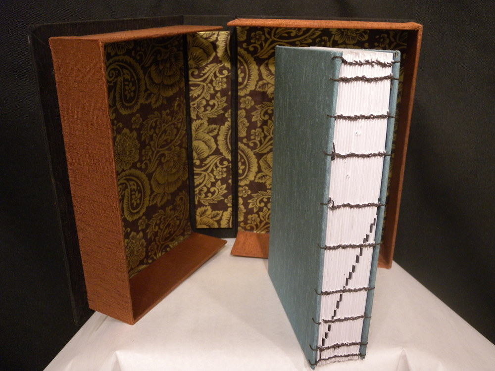 Textbook on book binding, hand bound with it's clamshell box.