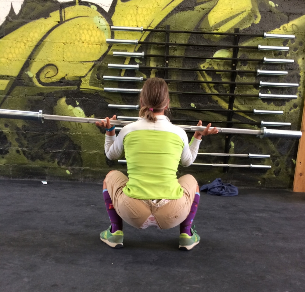 Tina stops at nothing to demonstrate a perfect front squat.