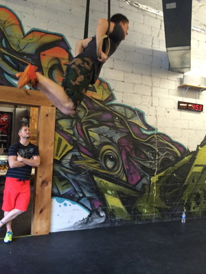 Dustin struggling through the end of the Muscle Ups on 15.3