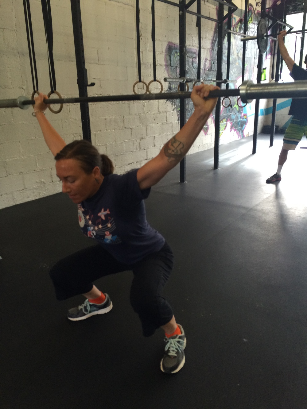 Darcy has been relentless in her pursuit of a solid overhead squat. I wish we had before and after pictures here, but her willingness to work with pvc pipe and training bars to move well is paying off. solid foundations build solid results.