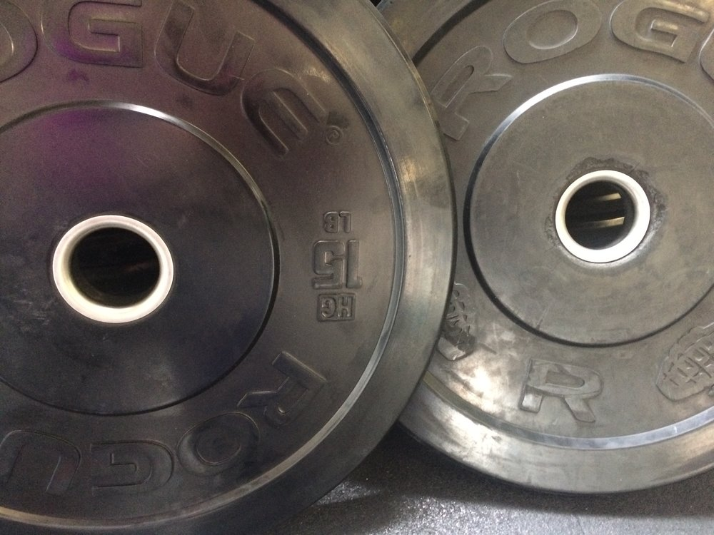 New bumpers (left) have nice tight center rings. Old bumpers (right) have loose rings and gouges in the rubber.