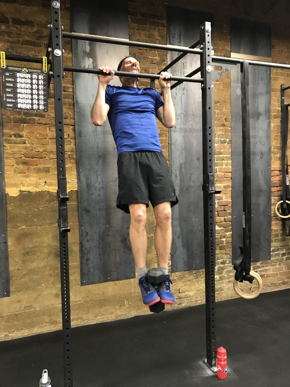 Paul busting out some weighted pull ups this week. That dumbbell looks good on you, Paul.