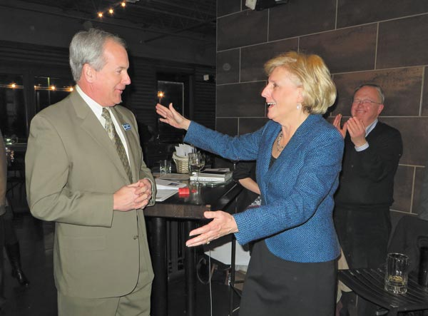 Arapahoe County Sheriff David Walcher greets Commissioner Nancy Sharpe at the reception in her honor, Feb. 25.