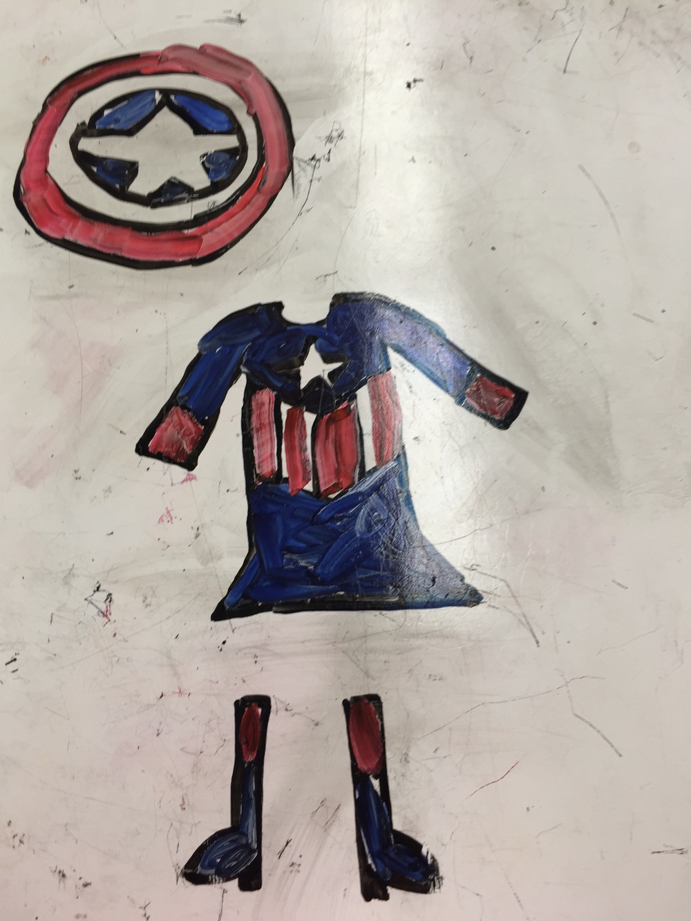 Thank you Grace for sharing your drawing! Her idea for this superhero outfit was inspired by Captain America's outfit.