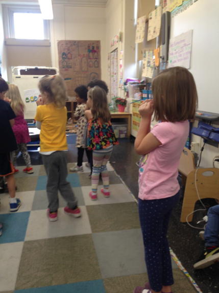 Kindergarteners transitioning from one activity to another by dancing to AROOSTASHA!