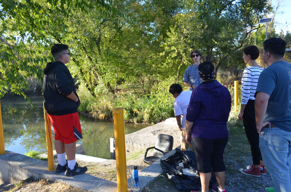 Brian Tonetti, Executive Director, explaining the city's hydrology to urban youth at Three Creeks Confluence | Photo: Grant Allen