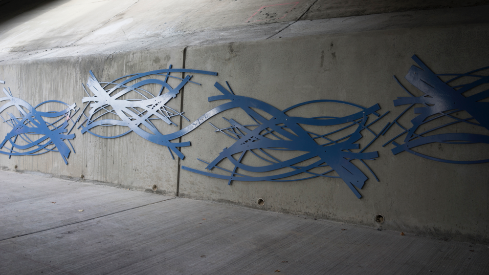 A placemaking sculpture to activate neglected space under the 1300 South underpass.