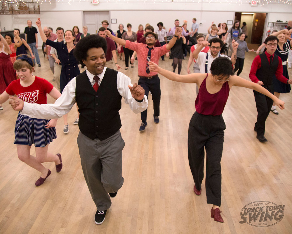 Nick Davis teaching swing at a dance hosted by his nonprofit organization, track town swing