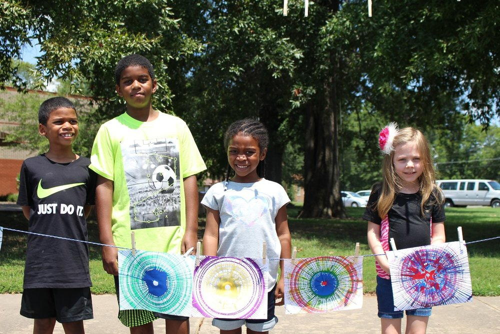 Visitors show off their pedal-art creations they made during Family FunDay on Aug. 11, 2018. Pedal-powered art is just one of the many activities planned during ASC's Tinkerfest 2018, to be held 1-3 p.m. Sept. 8.