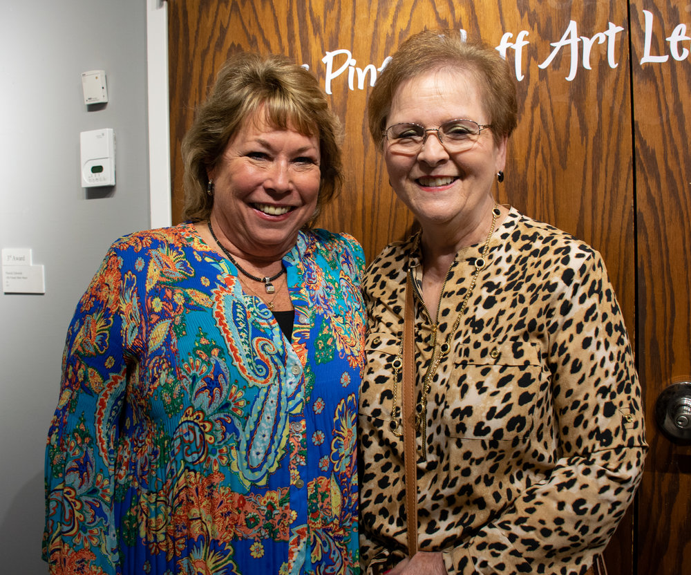 2018 Pine Bluff Art League Juried Exhibition Chair Melissa Abernathy (left) and Pine Bluff Art League President Vickie Coleman.
