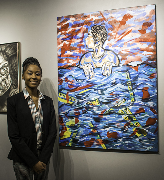 "Ashia Shelton and her painting ""Man Holding Water"" were part of the 2018 Annual Pine Bluff High School Art Exhibition at ASC."