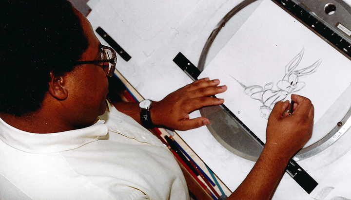 Byron Vaughns draws  Tiny Toon Adventures  character Buster Bunny at Warner Bros. Studios in the early 1990s. Vaughns, who graduated from UAPB and lives in White Hall, won an Emmy in 1993 when he was director of the cartoon series. PHOTO COURTESY BYRON VAUGHNS, COPYRIGHT WARNER BROS. STUDIOS AND BYRON VAUGHNS