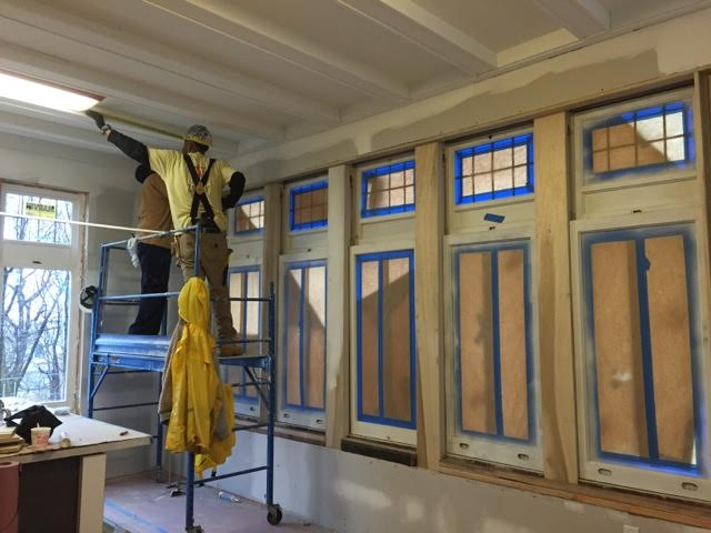 Pictured above: restoring the beamed ceiling.
