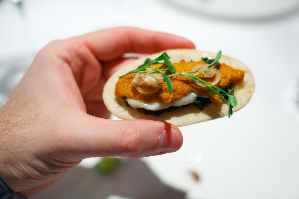 Sope de erizo y papa, hoja de rábano tatemado (Sea urchin sope with potato purée, fire-toasted radish leaf)