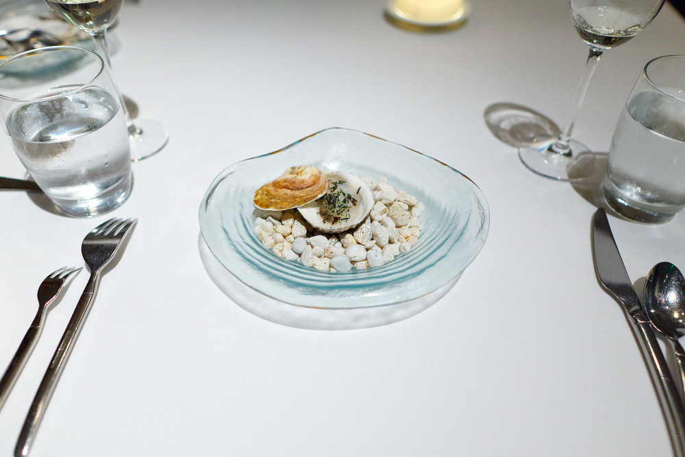 "3rd Course - ""An elemental oyster"" - Lightly poached in its own shell, ocean water gelée, nori flakes"