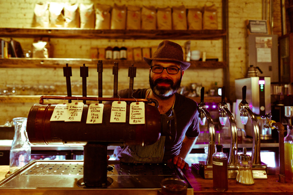 Owner Ben Sandler showing Coffee on Tap