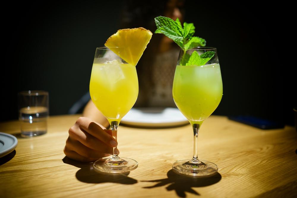 Aguas frescas: piña para la ñina (pineapple, almond, achiote) & pepino para el niño (cucumber, lime, mint)