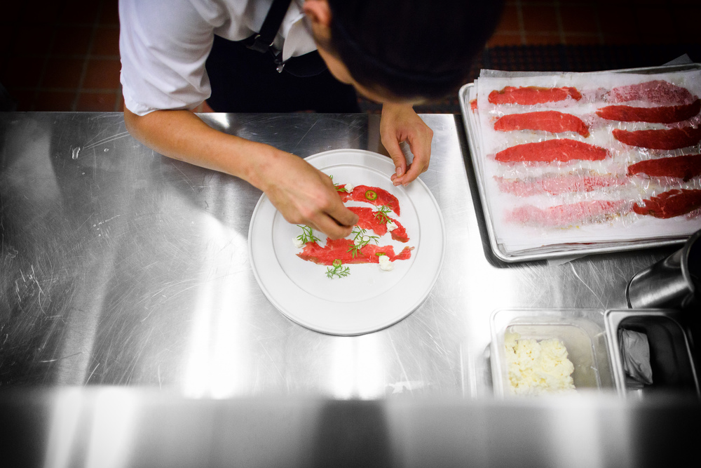 Chef Daniela Soto-Innes plating beef skirt carpaccio