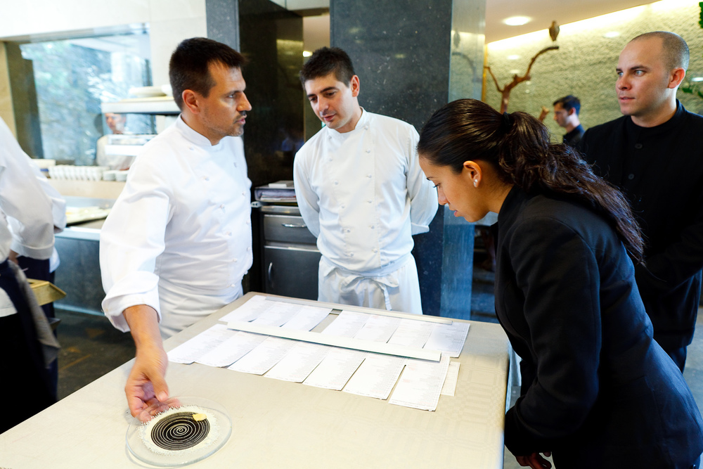 El Bulli, Spain - Oriol Castro going over diners' eating restrictions