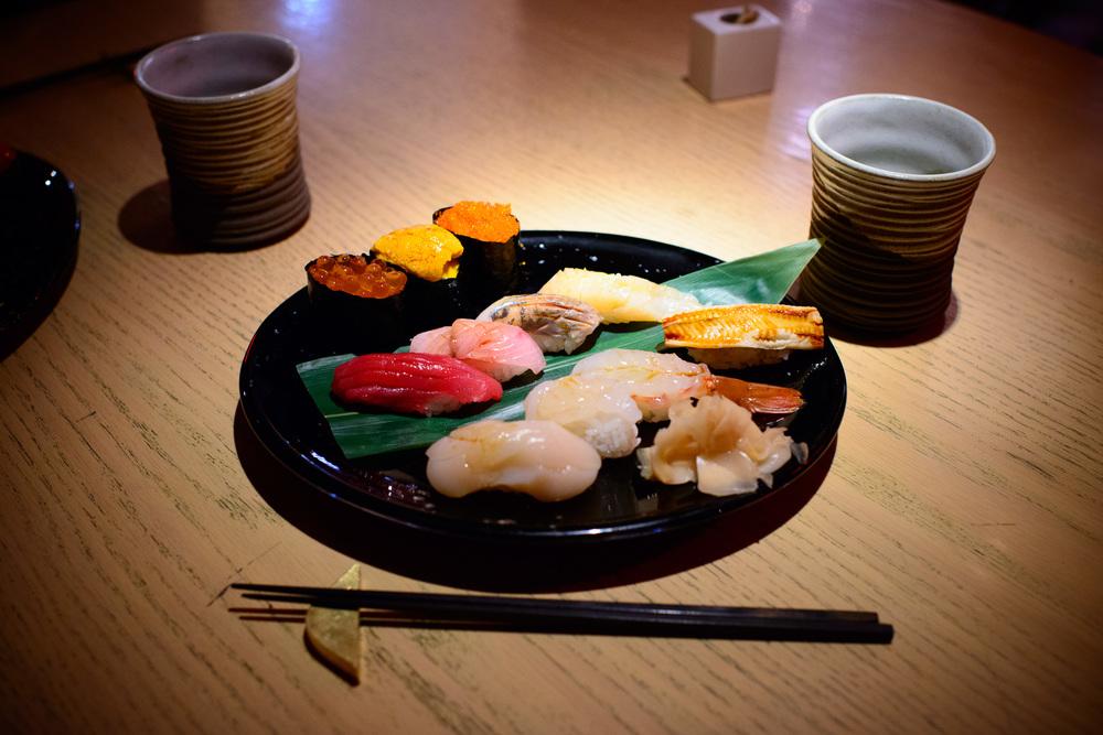 Assorted sushi: ikura, uni (santa barbara), tobiko, akami, buri,