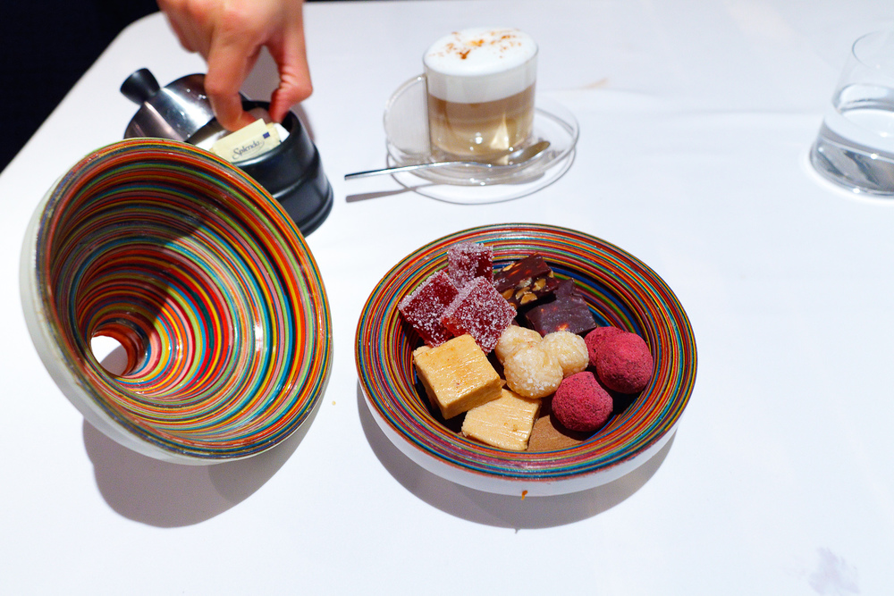 Petits fours: pâte des fruits, chocolate and hazelnuts, cocada (coconut ball), chocolate, Mexican mazapán (peanut squares)