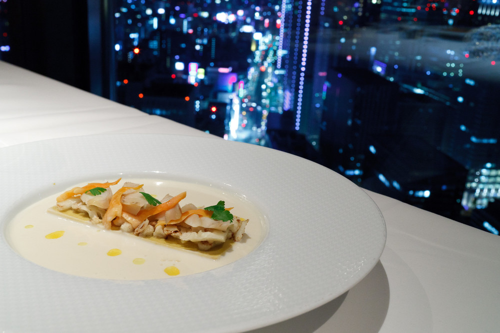 Signature, Tokyo - Cauliflower veloute with curry spice flavored mussels and shellfish delicate flan
