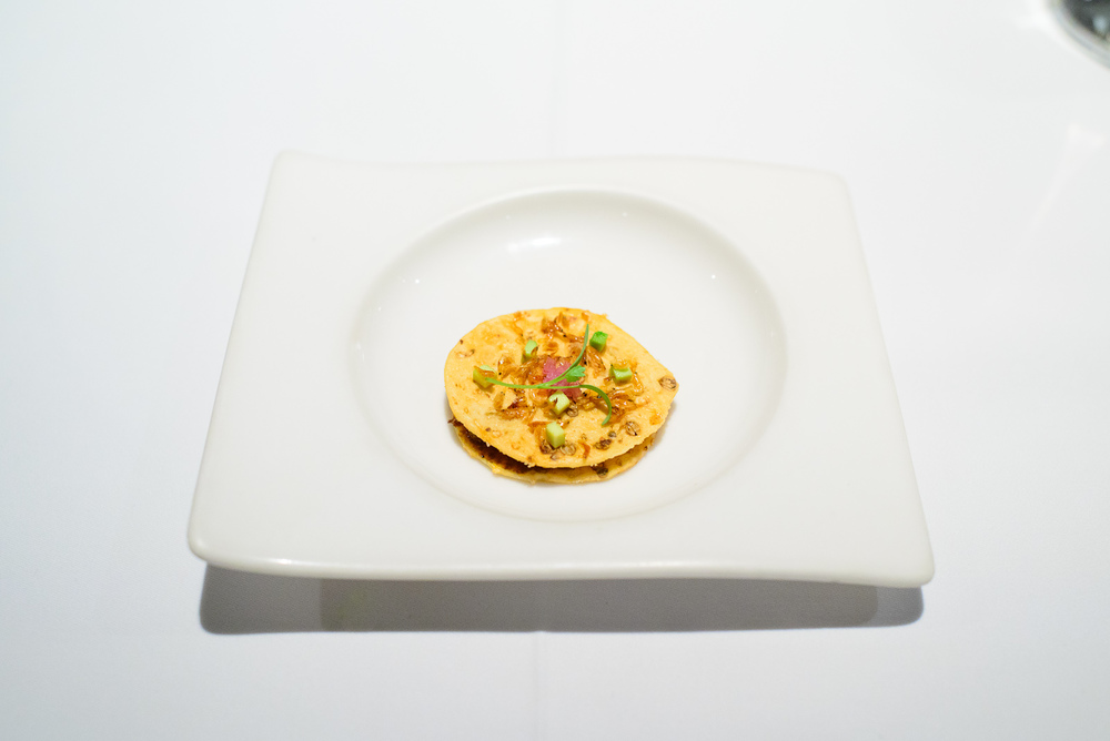 1st Course: Tostada de semilla de cilantro, salsa chintextle, mi