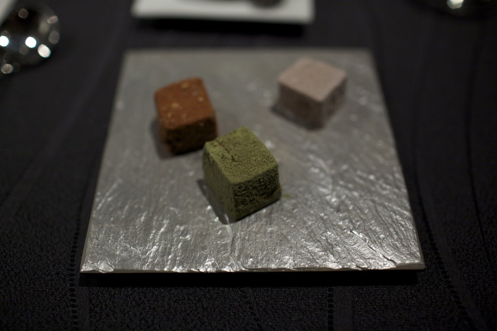 RyuGin - Petits Fours of Warabimochi cake in coconuts, genmai tea, and kinako powder